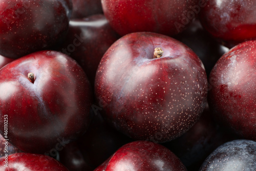 Canvas Print Tasty plums all over background, close up