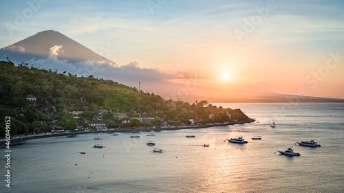 Obraz na plátně Landscape of Bali island north coastline at sunset, with Mount Agung volcano pea