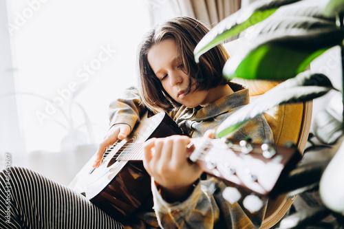 Fototapeta teenage girl playing guitar