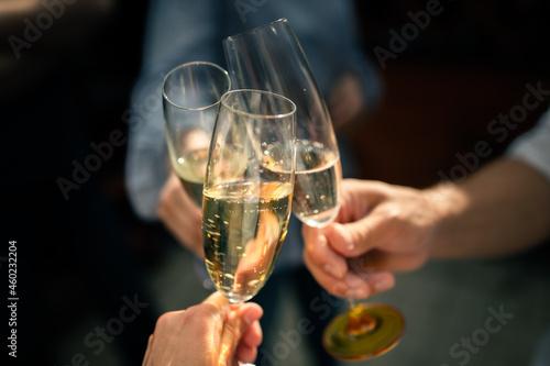 Billede på lærred Friends raise glasses of champagne at a party