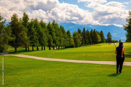 Photo Crans Sur Sierre Golf Course and Mountain View in Crans Montana in Valais, Switzerland