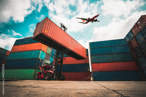Canvas Cargo container for overseas shipping in shipyard with airplane in the sky