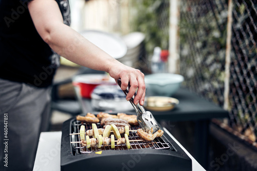 Fotografie, Tablou Preparing barbeque on a electrical modern grill outdoors.