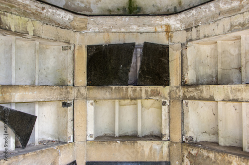 Fototapeta Old damaged burial chamber - columbarium
