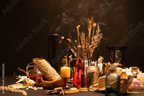 Obraz na plátně Witchcraft still life with black burning candles selective focus