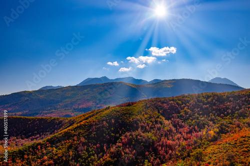 Sun setting over autumn mountains