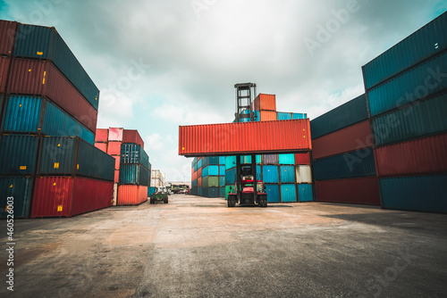 Fotografie, Obraz Cargo container for overseas shipping in shipyard with heavy machine