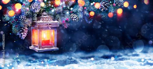 Obraz na plátně Christmas Lantern In Night With Snow And Fir Branch