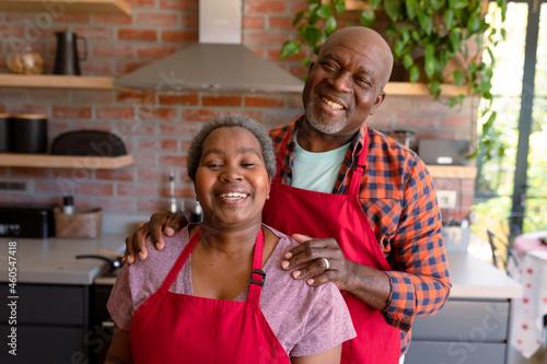 Portrait of happy african american senior couple in kitchen