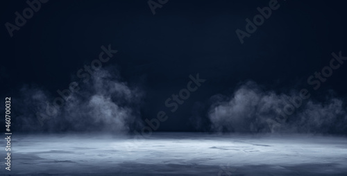 Gray textured concrete platform, podium or table with smoke in the dark