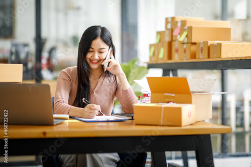 Tela Portrait of Starting small businesses SME owners female entrepreneurs working on receipt box and check online orders to prepare to pack the boxes, sell to customers, sme business ideas online