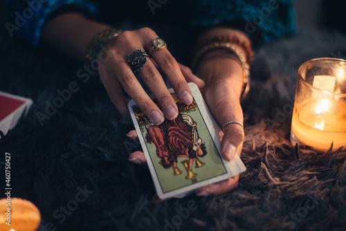 Photo Fortune teller holding tarot cards deck