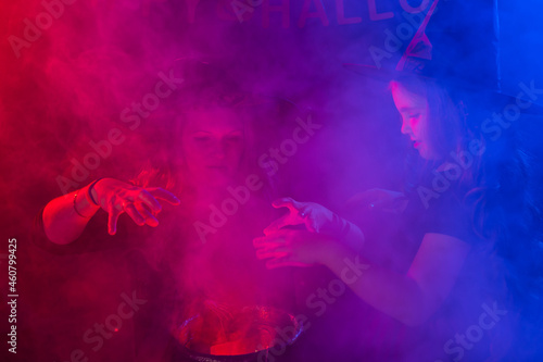 Two halloween witches making a potion and conjure in halloween night Fototapet