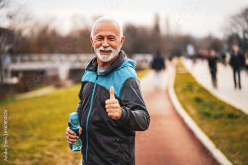 Slika na platnu Happy senior man is ready for exercising in park.