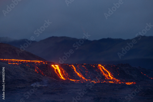 Hot landscape of an erupting volcano with fresh lava coming ot from the crater Fototapet