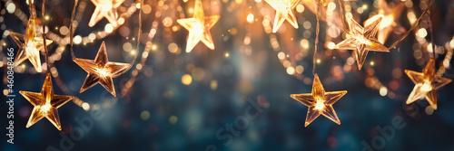 Gold star light hanging on dark background Fototapet