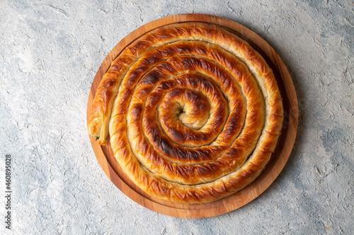 Fotografie, Obraz Turkish Tepsi Boregi, Round Borek, Tray pastry (Turkish name; rulo borek)