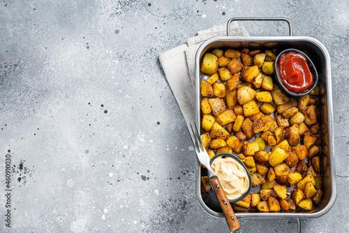Patatas bravas traditional Spanish potatoes snack tapas in a steel tray Fototapet