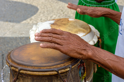 Fotografie, Obraz Percussionist playing a rudimentary atabaque during afro-brazilian cultural mani