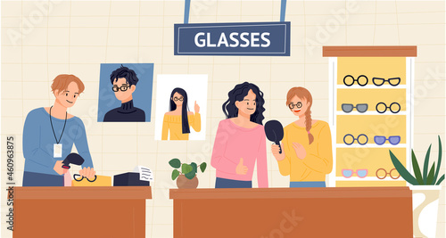 Fotografia People and clerk choosing glasses in an optician's shop