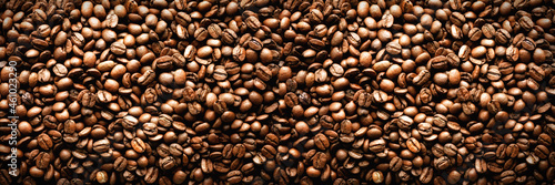 Fotografia Roasted coffee beans backgound, copy space, top view