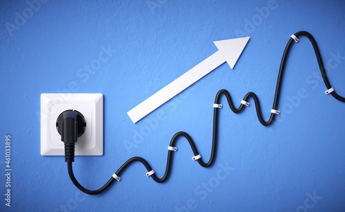 The price of electricity. Plug and cable concept with rising graph.