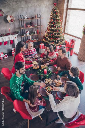Vertical photo friendly family having festive christmas dinner on winter holidays indoors apartment