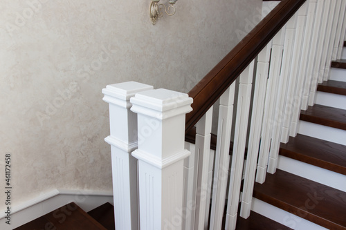 Fotomural wooden staircase with brown treads and white risers and balusters