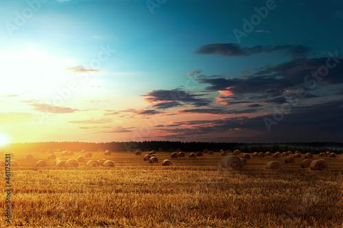 Obraz na plátně Haystacks on the background of dramatic sunset.
