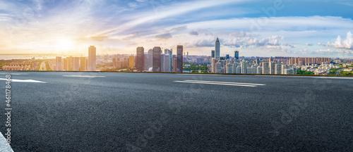 Fotografiet Empty asphalt road and city skyline and building landscape, China