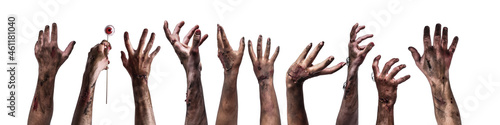 Many hands of scary zombies on white background