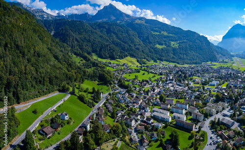 Fotografie, Obraz Aerial view of the city Mollis in Switzerland on a sunny day in summer