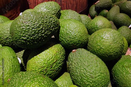 Fototapeta Heap of fresh green avocado selling at the market stall.