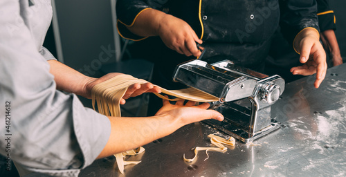 Tela Close up photo pf pasta making process in a professional kitchen.