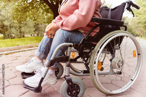 young disabled woman in a wheelchair. Depersonalization. Fotobehang