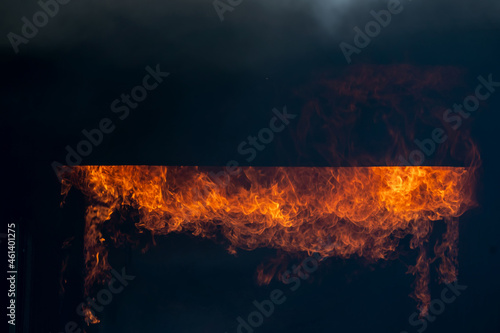 Fotografie, Tablou The fire is burning,Fire flame in fireplace glowing burning on black dark background