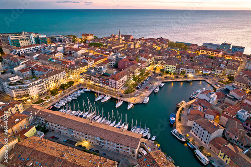 Fototapeta Town of Grado colorful architecture and waterfront aerial evening view