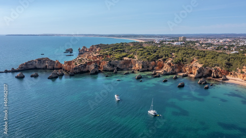 Fotografie, Obraz Beautiful seascape from the air, paradise bay with a yacht, Portuguese beaches, algarve