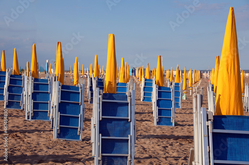 Canvas beaches with umbrellas closed and deck chairs closed at the end of the bathing s