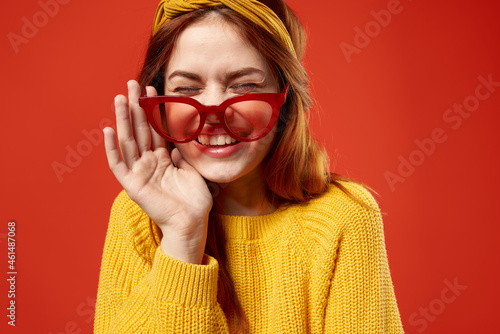 woman with yellow headband red glasses fashion yellow sweater Fototapet