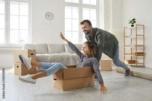 Fototapeta Happy young married couple having fun on moving day
