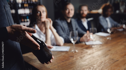 Fotografie, Tablou Banner Male sommelier conducts red wine tasting for restaurant guests