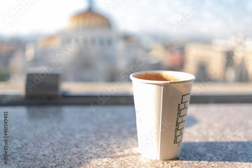 Obraz na plátně White paper cup with blurry Palace of Fine Arts as background