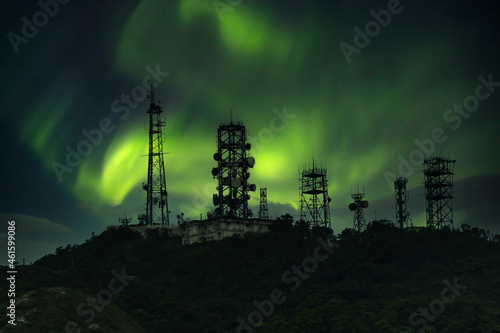 telecommunication tower with telecom broadcasting antenna on mountain Fototapet