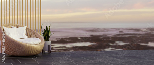 Empty space for montage with stylist wicker chair, plant and ocean sea view in the background