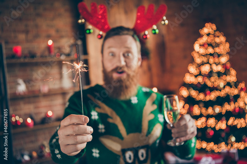 Canvastavla Photo of crazy funny funky guy hold glass champagne bengal fire wear reindeer he