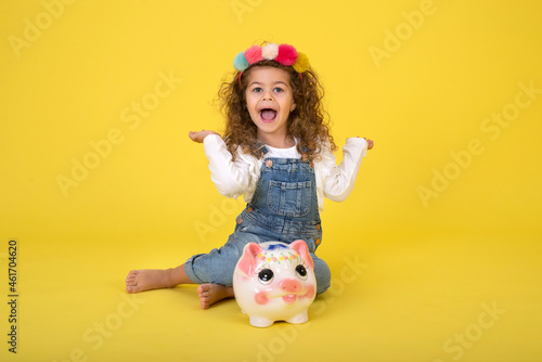 Fotografiet Happy  Little Children girl  saved a little money for future need wearing white