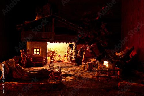 Obraz na plátně Still of a home made carved manger depicting the birth of Jesus Christ in dark l