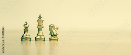 Fotografiet Close-up King chess Bishop and Knight standing teamwork on chess board concepts of business team and leadership strategy and organization risk management or team player
