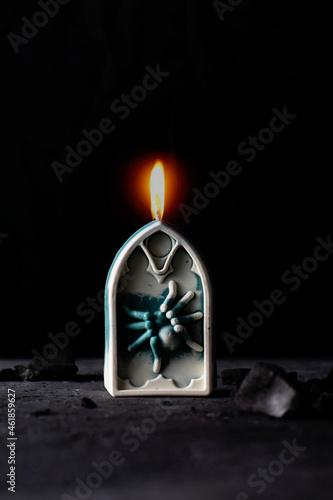 Decorative horror candle headstone on a black background. Fototapet